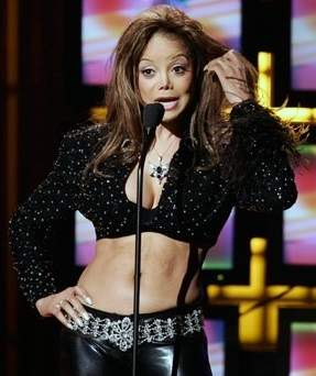 La Toya Jackson plastic surgery, La Toya Jackson photos, La Toya Jackson cosmetic surgery, La Toya Jackson breast implants, breast augmentation, botox, cheek implants, liposuction0